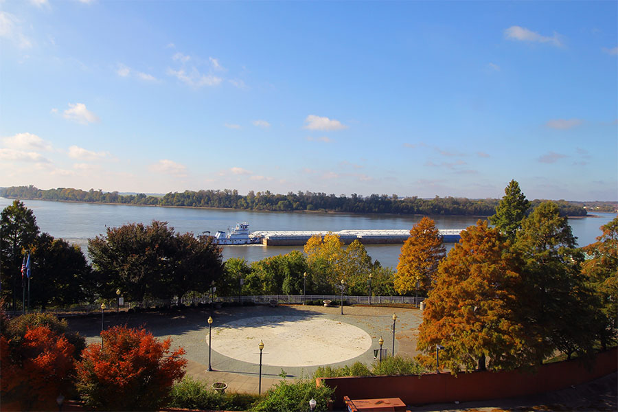 Evansville IN - Scenic View of a River with a Ship Surrounded by Colorful Fall Foliage in Evansville Indiana
